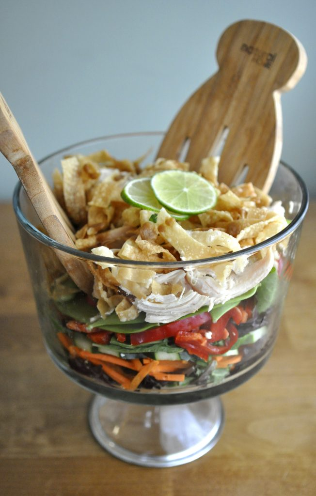 A layered salad with lime vinaigrette and Thai peanut sauce. Photo by Adriana Janovich
